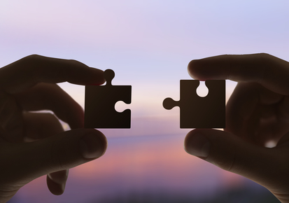 two hands collect the puzzle